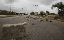 Rocks and pieces of concrete lie strewn across a road in Duduza on 22 February 2017 following overnight protests over service delivery in the area. Picture: Reinart Toerien/EWN.