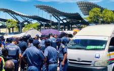 SA Police Service officers visiting the Bellville taxi rank in Cape Town as part of Safer Festive Season operation. Picture: SAPS.