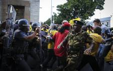 Police intervene as clashes between ANC and EFF members take place outside parliament in Cape Town ahead of President Jacob Zuma's 2016 State of the Nation address. Picture: Thomas Holder/EWN.