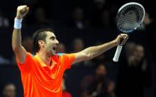 Croatia's Marin Cilic celebrates after defeating Germany's Tommy Haas in their final match of the Croatian ATP PBZ Indoors tennis tournament in Zagreb on 9 February 2014. Picture: AFP.