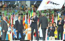FILE: Valentin Balakhnichev waves the IAAF flag during a handover ceremony at the end of the final day of the IAAF World Championships in 2011. Picture: AFP.