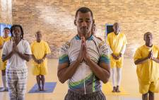 Bradley Hess and other prisoners take part in a yoga class presented at the Malmesbury correctional facility. Picture: Aletta Gardner/EWN