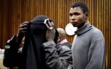 Takalani Netshikuni and Stephen Safara, two men accused of breaking into songress' Lira's house, appeared at the Randburg Magistrates Court on 12 August 2013. Picture: Sebabatso Mosamo/EWN