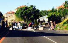 Students barricade one of the main roads leading to UCT's main campus. Picture: Shamiela Fisher/EWN