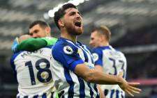 Brighton's Iranian midfielder Alireza Jahanbakhsh celebrates after Brighton's Dutch midfielder Aaron Mooy scores his team's second goal during the English Premier League football match between Brighton and Bournemouth at the American Express Community Stadium in Brighton, southern England on 28 December 2019. Picture: AFP.