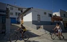 People walk past the Taqwa mosque, where suspected jihadist gunman named as Moroccan national Ayoub El Khazzani allegedly attended services, on 23 August, 2015 in the El Slaldillo quarter of Algeciras. Picture: AFP.