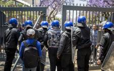 FILE: Campus security close one of the University of Pretoria's Hatfield campus' gates during protests outside campus. Picture: Reinart Toerien/EWN..