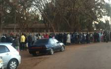 Hundreds of voters queue at a local voting station to cast their votes in the 2018 Zimbabwe presidential elections on 30 July 2018. Picture: Clement Manyathela/EWN