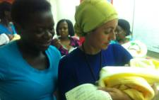 Home Affairs Deputy Minister Fatima Chohan (R) holds a baby that was born on 1 January, 2013 at the Charlotte Maxeke Academic Hospital. Picture: Theo Nkonki/EWN
