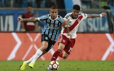 Argentina's River Plate Exequiel Palacios (R) vies for the ball with Brazil's Gremio Everton during their Copa Libertadores 2018 football match held at the Arena do Gremio stadium, in Porto Alegre, Brazil, on 30 October 2018. Picture: AFP