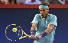 Rafael Nadal of Spain hits the ball against Fabio Fognini of Italy during day eight of the Rogers Cup at IGA Stadium on 9 August 2019 in Montreal, Quebec, Canada. Picture: AFP