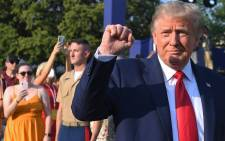 "US President Donald Trump pumps his fist as he arrives for the 2020 ""Salute to America"" event in honour of Independence Day on the South Lawn of the White House in Washington, DC, 4 July 2020. Picture:AFP"