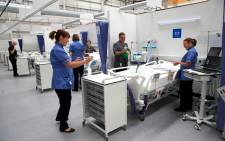 Staff prepare bays at the NHS Nightingale Hospital North East in Sunderland, northeast England on 5 May 2020 providing 460 beds for patients with coronavirus. Picture: AFP