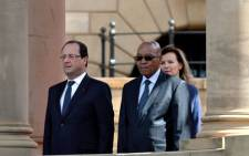 President Jacob Zuma (R) stands with French President Francois Hollande (L) and his companion Valerie Trierweiler (back-R) at the Union Buildings in Pretoria on 14 October 2013. Picture: AFP /ALEXANDER JOE