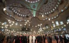 In this handout picture released by the Vatican press office Pope Francis visits the Blue Mosque (Sultan Ahmet mosque) with Mufti Rahmi Yaran on 29 November, 2014 in Istanbul. Picture: AFP.