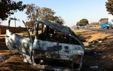 A burnt-out taxi in Lilongwe after the 20 July protests in Malawi. Picture: Barry Bateman/EWN