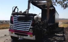 A delivery truck was burnt during protests in Leratong on 10 October 2013. Picture: Sebabatso Mosamo/EWN