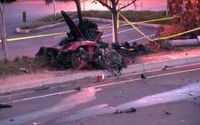 A screen grab from a CNN report showing the wreckage of the fatal accident involving Actor Paul Walker. Picture: CNN