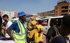Member of the mayoral committee for transport in the city of Johannesburg, Nonhlanhla Makhuba at the Doornfontein taxi rank. Makhuba engaged with taxi operators and commuters before they travel for the annual Easter break. Picture: Sethembiso Zulu/ EWN