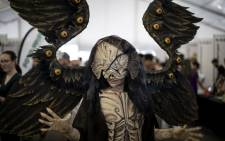 A cosplayer poses at the first ever multi-genre entertainment comic and fan convention Comic-Con Africa in Johannesburg on 14 September 2018.  Picture: AFP.