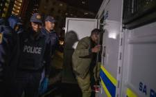 FILE: Police moving detainees. Picture: EWN
