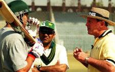 FILE: Former England's cricket team opener Geoff Boycott (R) talks with Pakistani opener Shahid Afridi (L) in this Pakistani eastern city of Lahore, 7 February 2001. Picture: AFP.