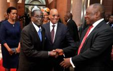 President Jacob Zuma and his deputy Cyril Ramaphosa receive Zimbabwe President Robert Mugabe at the Union Buildings on his state visit on 8 April 2015. Picture: GCIS.
