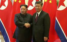 Chinese President Xi Jinping and North Korean leader Kim Jong Un shaking hands during their meeting in Beijing on 27 March 2018. Picture: AFP
