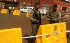 SANDF officials are guarding the landing strip here at the Air Force Base in Pretoria. Picture: Mia Lindeque/EWN