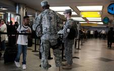 Soldiers stand guard LaGuardia airport. Picture: Getty Images/AFP.