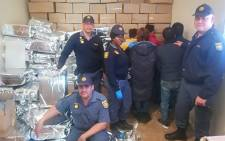 Police in the Northern Cape have nabbed six suspects who are thought to be linked to a counterfeit goods production factory in Hartswater. Picture: SAPS/Facebook.