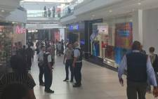 Security personnel secure the area following an attempted robbery at the Dion Wired store at the Cresta Shopping Centre in Johannesburg on 8 October 2019. Picture: Intelligence Bureau SA