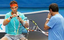 Rafael Nadal makes adjustments to his racquet during pre-match training at the 2015 Australian Open on 19 January 2015 in Melbourne. Picture: Official Australian Open Facebook