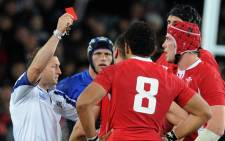 FILE: Referee Alain Rolland of Ireland gives a red card to Wales' flanker Sam Warburton (not pictured) during the 2011 Rugby World Cup semi-final match Wales vs France at the Eden Park in Auckland on 15 October 2011. Picture: AFP