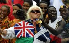 File picture taken on June 4, 2002 of Jimmy Savile, a television and radio celeberity joining in with people representing Commonwealth countries wearing their tradional dress crowd into the forecourt of Buckingham Palace during the Golden Jubilee celebrations in London. Picture: AFP.