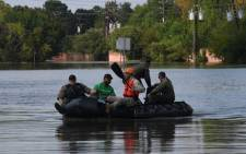 Military and state troopers help evacuate a man beside the spillway area of the Barker Reservoir in the Coldine are a after Hurricane Harvey caused widespread flooding in Houston, Texas on 31 August 2017. Picture: AFP.