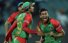 Bangladesh players celebrate their win against England in the Cricket World Cup match on 9 March 2015. Picture: CWC.