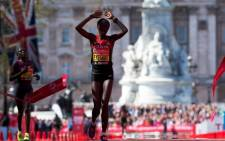 Edna Kiplagat of Kenya crosses the line to win the women's race in the 2014 London Marathon on The Mall in central London on 13 April, 2014. Picture: AFP.