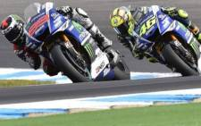 Prior to the race Valentino Rossi led the title by seven points from Jorge Lorenzo, but was forced to start from the back of the grid for the final race, following a collision with Marc Marquez. Picture: Morebikes.