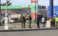 FILE: eSwatini soldiers and police. Picture: AFP