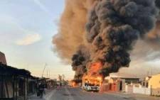 Golden Arrow Bus on fire during protests in Khayelitsha and surrounding areas. Image: @thobelawem/Twitter