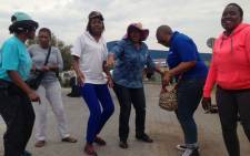 FILE: Women sing and dance outside the Tshwane Mail Centre in Pretoria as the Post Office strike continues across the country on 15 October 2014. Picture: Vumani Mkhize/EWN.