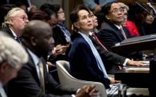Myanmar's State Counsellor Aung San Suu Kyi (C) stands before the UN's International Court of Justice on 11 December 2019 next to Abubacarr Tambadou (2L), minister of justice of the Gambia, in the Peace Palace of The Hague, on the second day of her hearing on the Rohingya genocide case. Picture: AFP