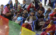 Relatives of Mount Everest avalanche victims wait for the mortal remains of their loved ones to arrive at the Sherpa Monastery in Kathmandu on April 19, 2014. Picture: AFP.