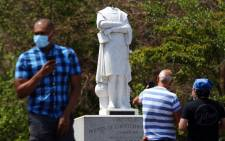 People photograph a statue depicting Christopher Columbus which had its head removed at Christopher Columbus Waterfront Park on June 10, 2020 in Boston, Massachusetts. Picture: AFP.