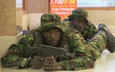 An image grab taken from AFP TV shows Kenyan troops taking position on September 21, 2013 inside the Westgate mall in Nairobi where Somali militants claimed responsibility for the killing of at least 59 people. Picture: NICHOLE SOBECKI/AFP.