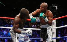 Floyd Mayweather Jr. throws a right at Andre Berto during their WBC/WBA welterweight title fight at MGM Grand Garden Arena on 12 September, 2015 in Las Vegas, Nevada. Picture: AFP.