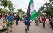 Protesters march at Alausa, the Lagos State Secretariat, in Lagos on 20 October 2020, after the Governor of Lagos State, Sanwo Olu, declared a 24 hour curfew in Nigeria's economic hub Lagos as violence flared in widespread protests that have rocked cities across the country. Picture: AFP