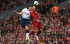Tottenham Hotspur defender Jan Vertonghen (L) vies with Liverpool forward Roberto Firmino (R) during their English Premier League match at Anfield in Liverpool, England on 31 March 2019. Picture: AFP