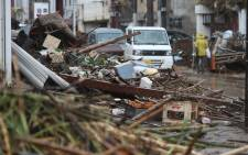 Picture shows a street covered by Debris in a flood-affected area following torrential rain in Hitoyoshi, Kumamoto prefecture, on 5 July 2020. Picture: AFP